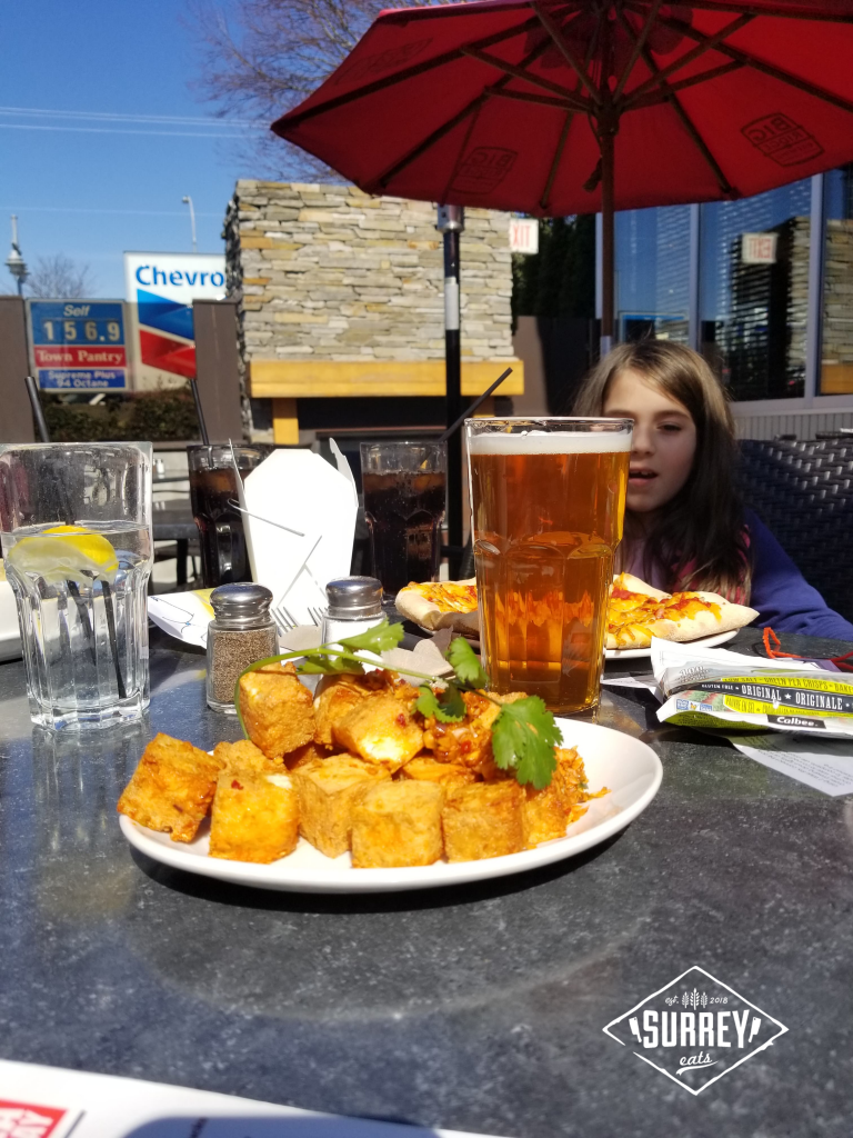 Spicy Tofu appetizer and beer on table at Big Ridge Brewing