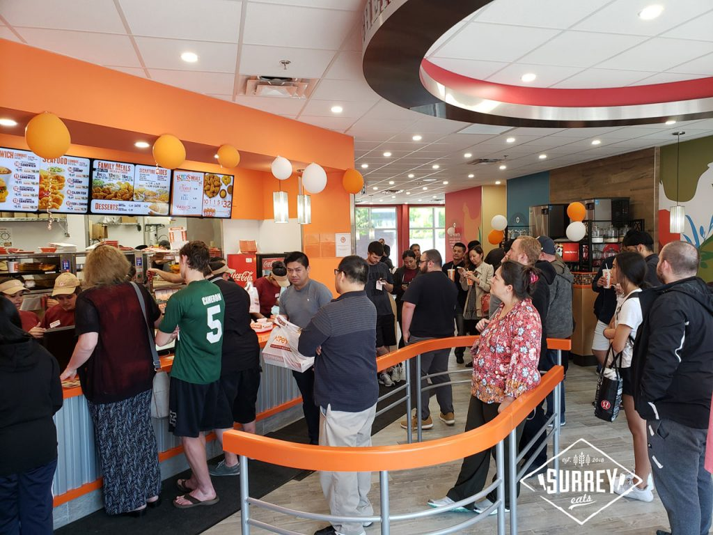 A crowd of people queuing up at Popeyes new Surrey, BC location