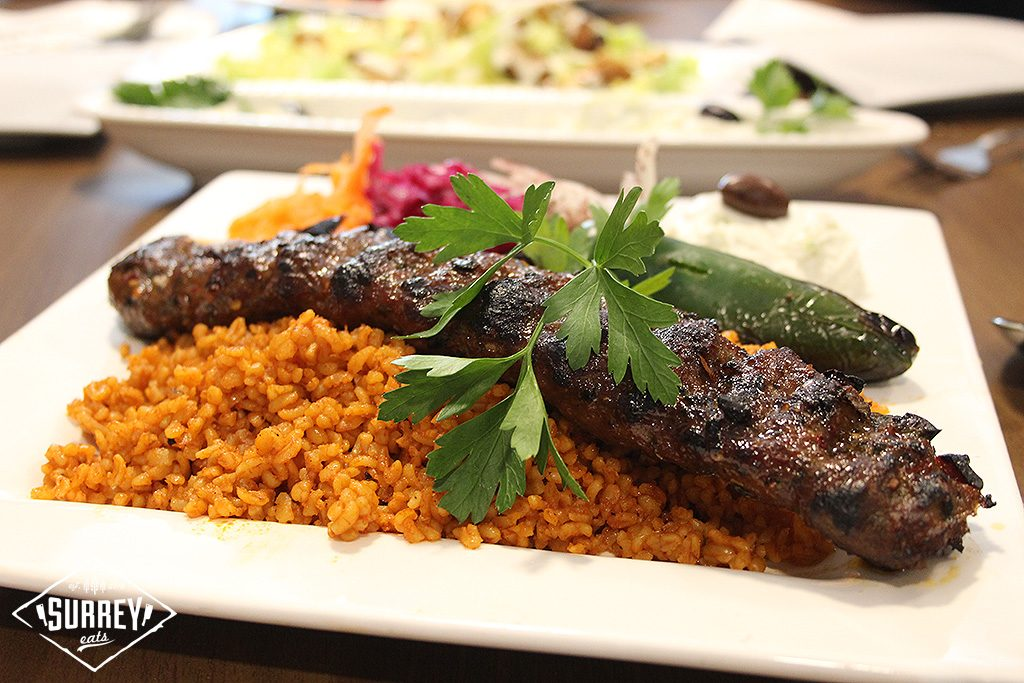 Adana Kebab, a mix of beef and lamb cooked on a skewer and served on a bed of bulgur