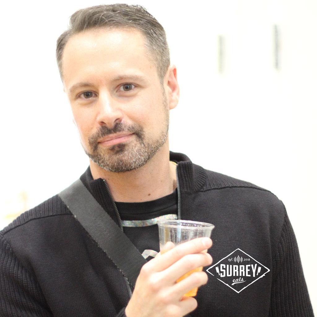 Surrey eats blogger holding Bajan rum