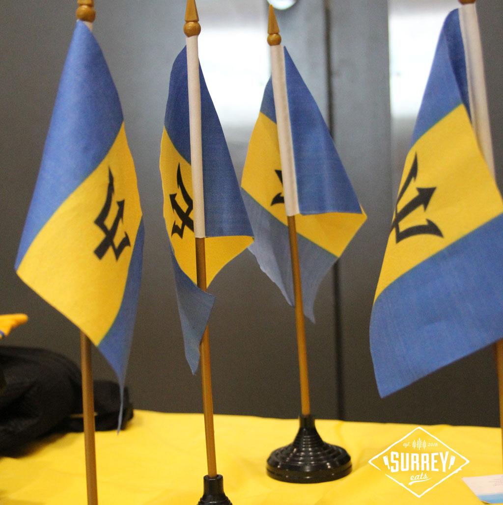 Four small Barbados flags