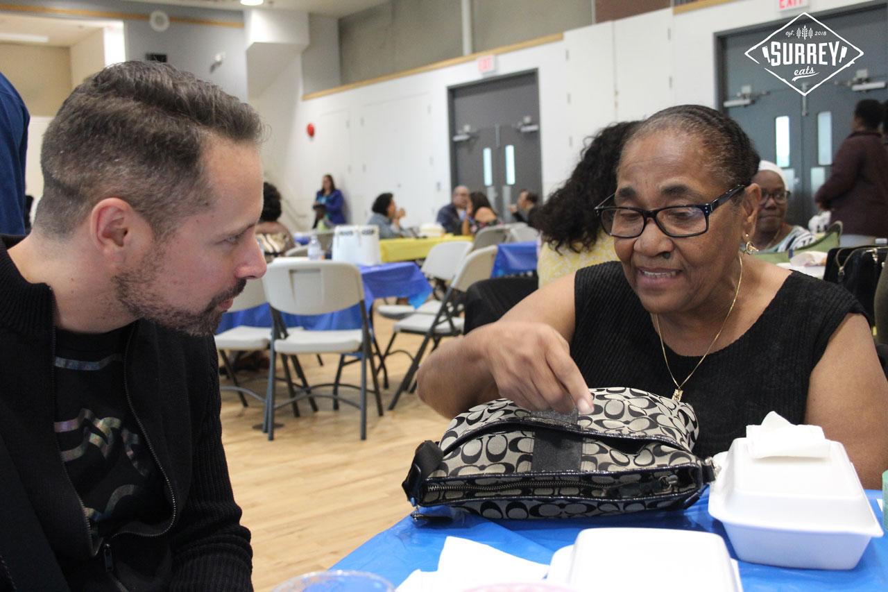 A woman talking to Surrey Eats foodblogger Matt