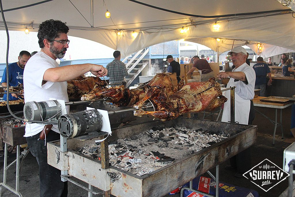 Men roasting whole lamb at the Surrey Greek Food Festival