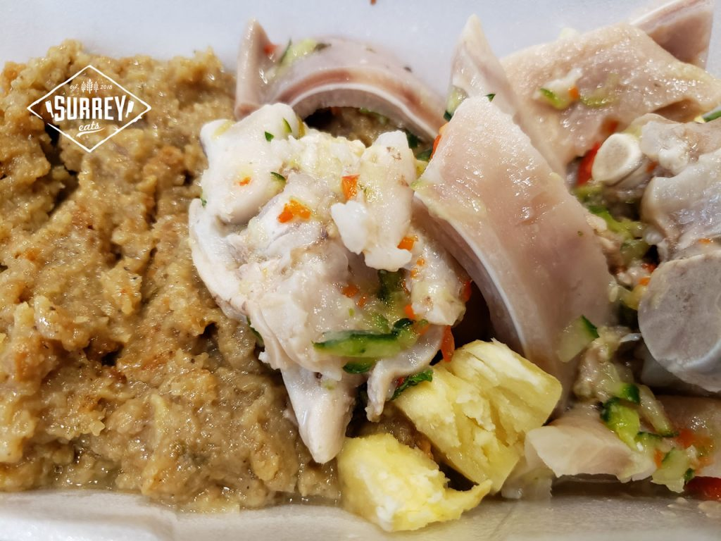 Pudding and souse, a Bajan dish featuring pig's feet and breadfruit