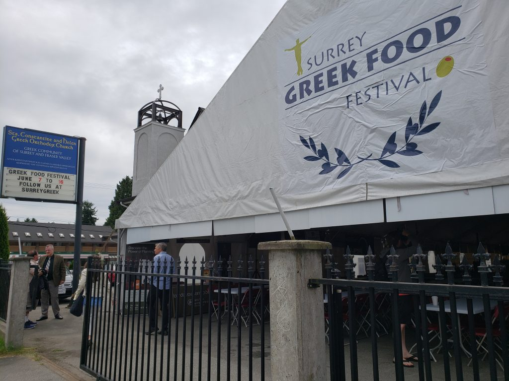 Surrey Greek Food Festival tent with Sts. Constantine and Helen Greek Orthodoxy Church in the background