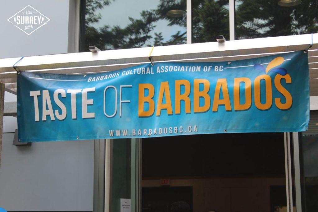 """Taste of Barbados banner reads """"Barbados Cultural Association of BC - Taste of Barbados - www.barbadosbc.ca"""""""