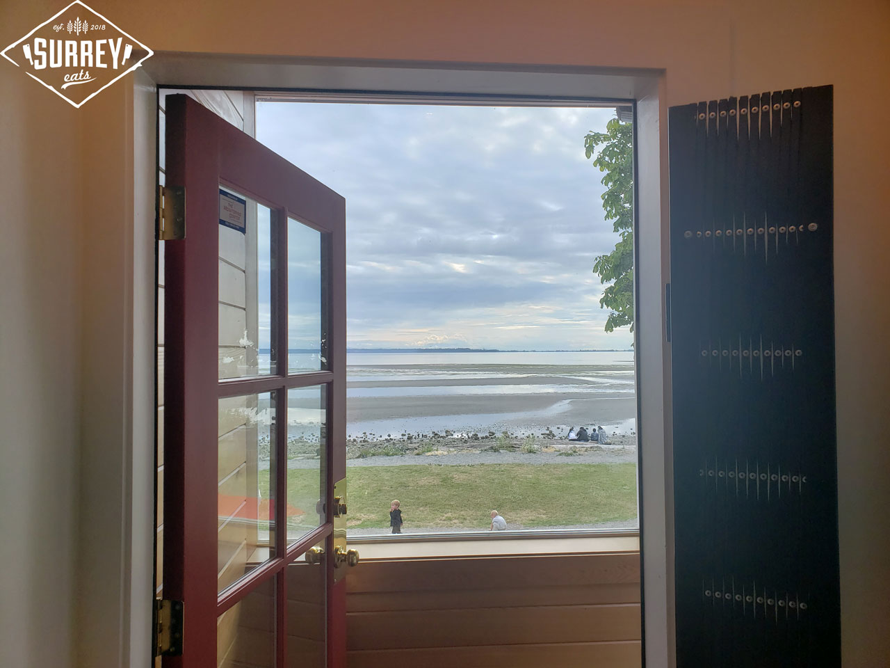 Crescent Beach viewed through the front door of Cotto al Mare restaurant