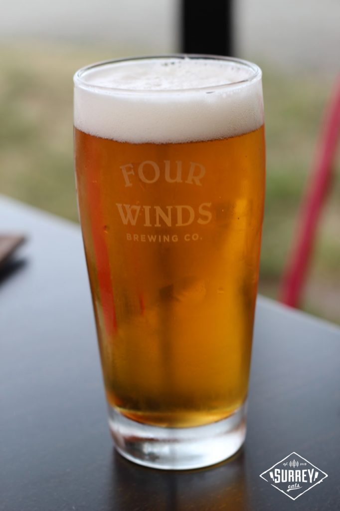 A tall glass of Four Winds beer