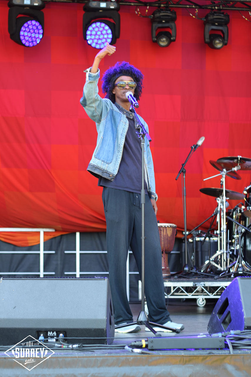 K'naan giving a thumbs up to the crowd at Surrey Fusion Fest