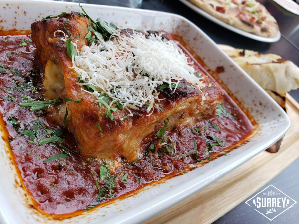 Lasagna Carne topped with parmesan