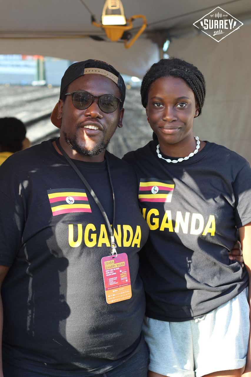 Two Ugandans wearing Uganda shirts