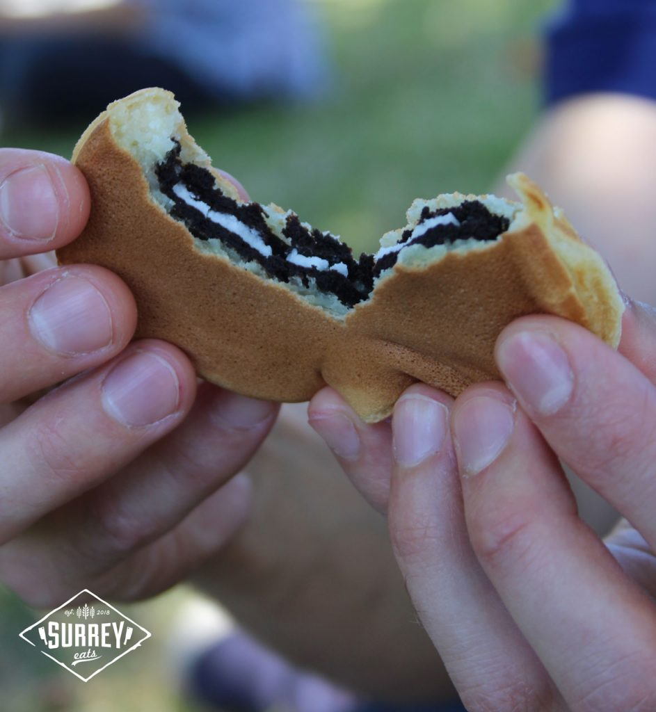 Breaking open a wheelcake to reveal the Oreo cookie filling