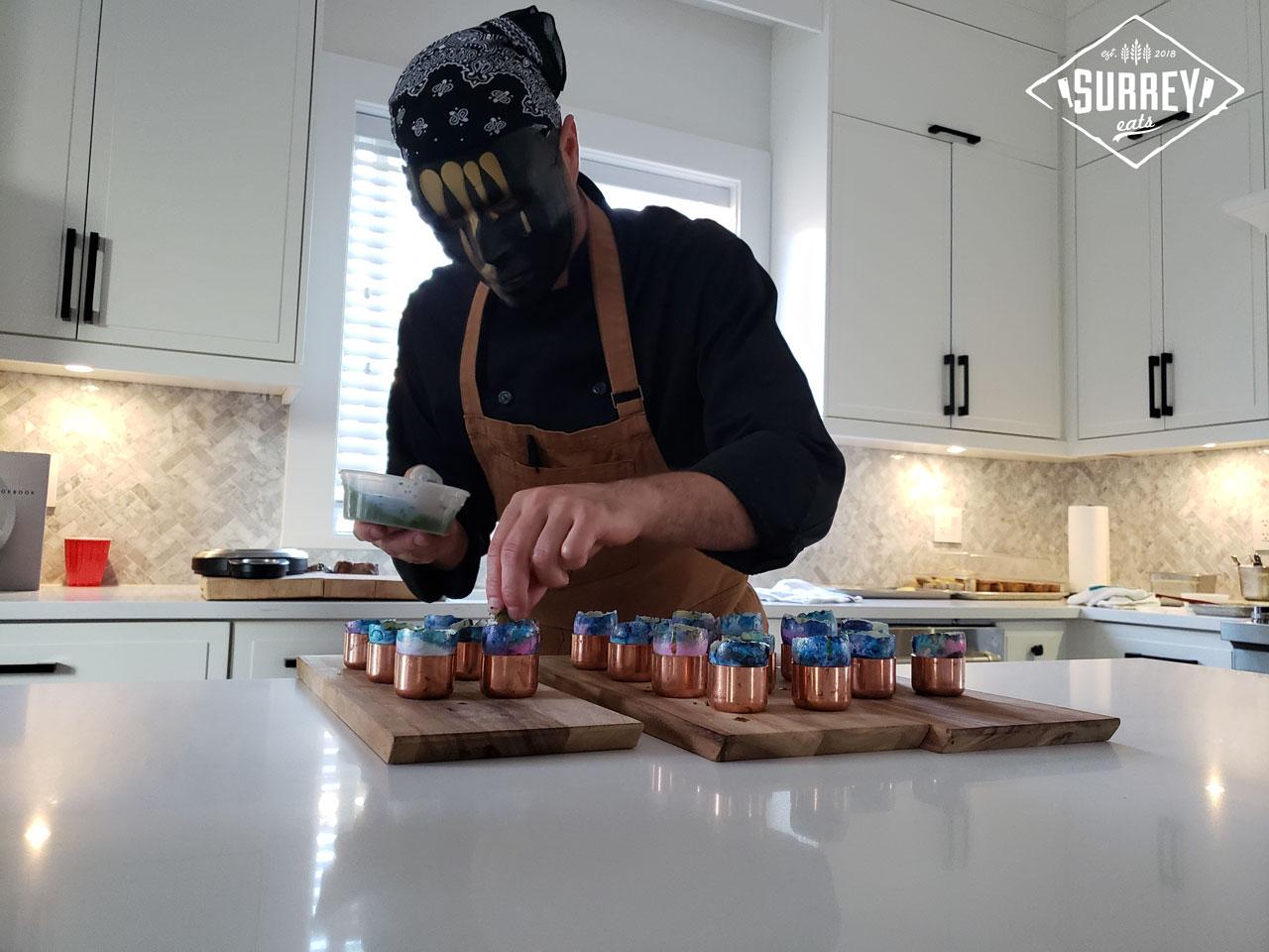 A Black Market Supper Club chef sprinkles fresh scallions onto truffle custard