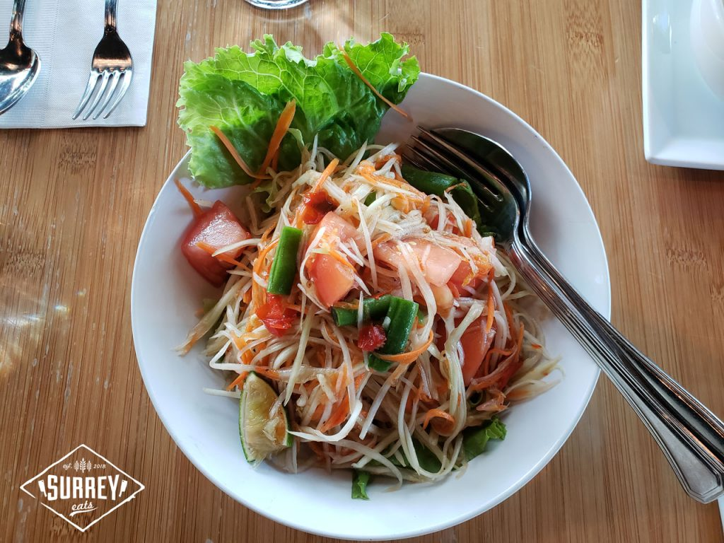 Papaya salad from Nahm Thai Bistro is pictured from a top-down perspective.