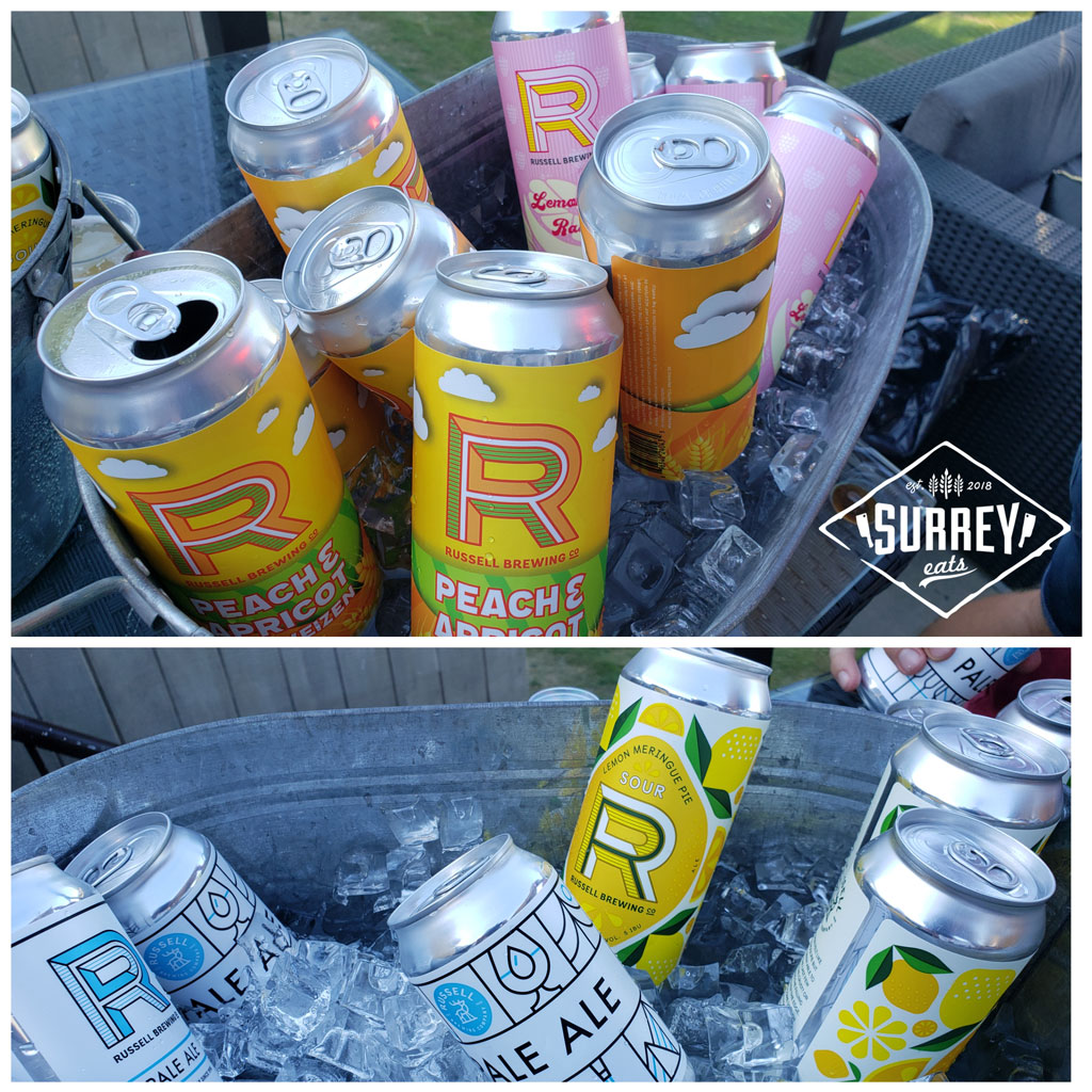 Cans of Russell Brewing's beer varieties are stored in buckets of ice