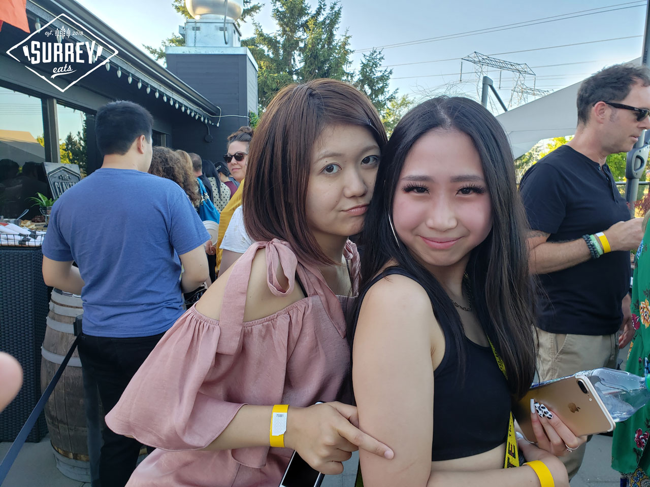 Selina and Atsumi from VancityNoms posing fron to back