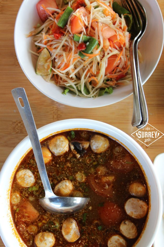 Top down view of the som tum Papaya Salad and Tom Yum Chicken soup