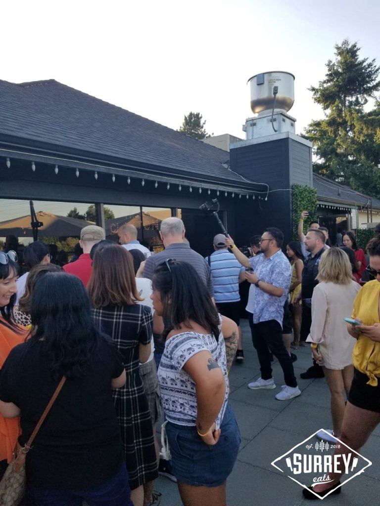 A crowd lines up for food at Surrey Eats Summer Social