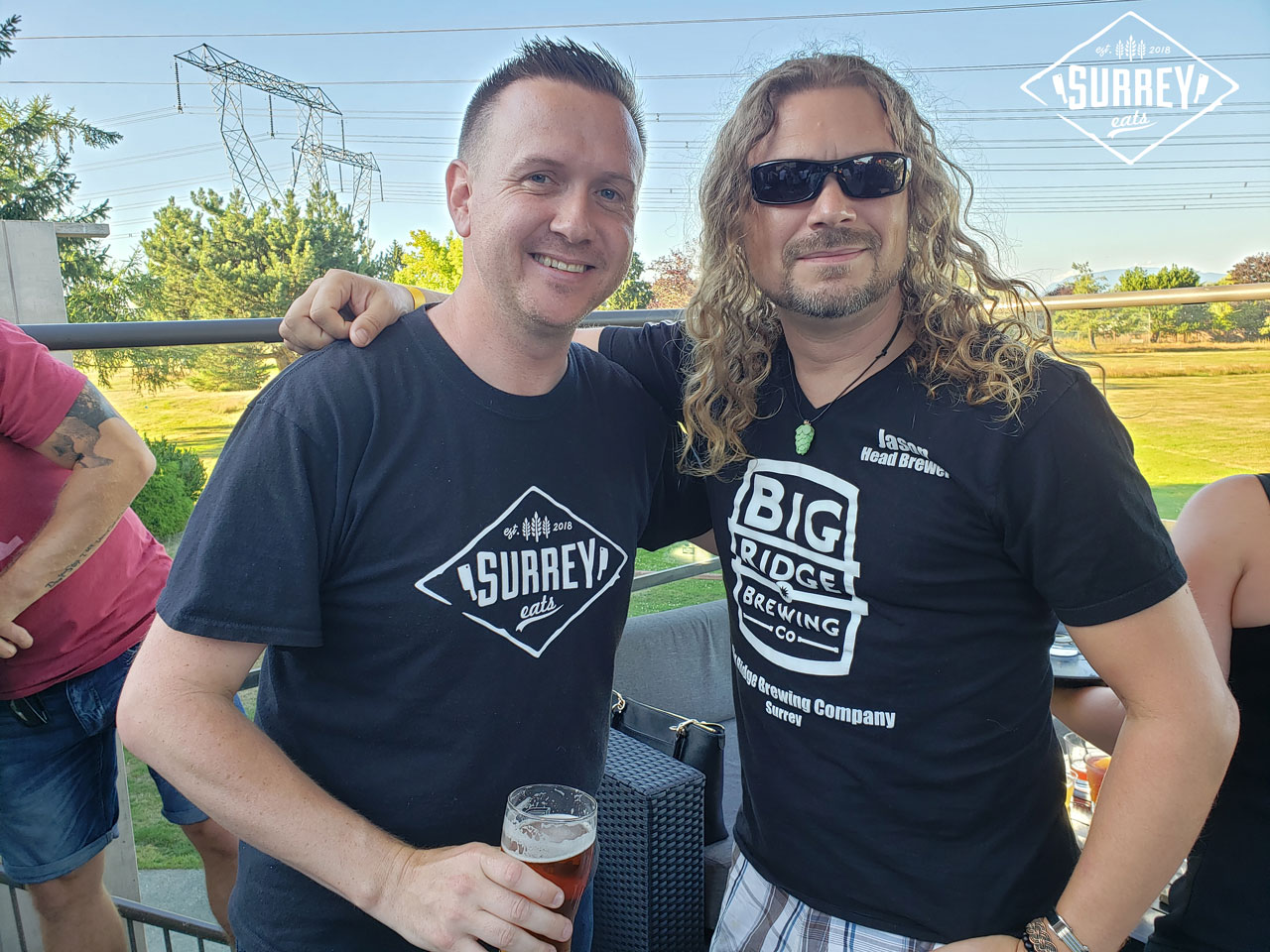 Craig from Surrey Eats holds a beer while standing with Big Ridge Brewing