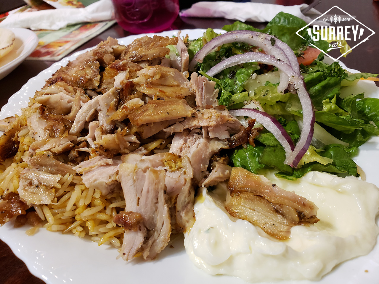 A Chicken Shawarma platter from Kababji Grill in Surrey with rice, salad, tzatziki