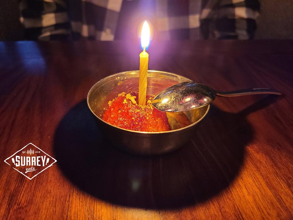 one Galub Jamun wiyh a birthday candle in it