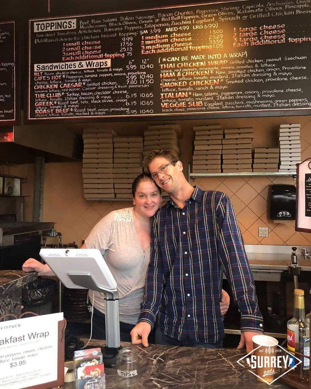 Ana and Neil, owners of Pepperoni Cafe behind the counter at their Surrey restaurant