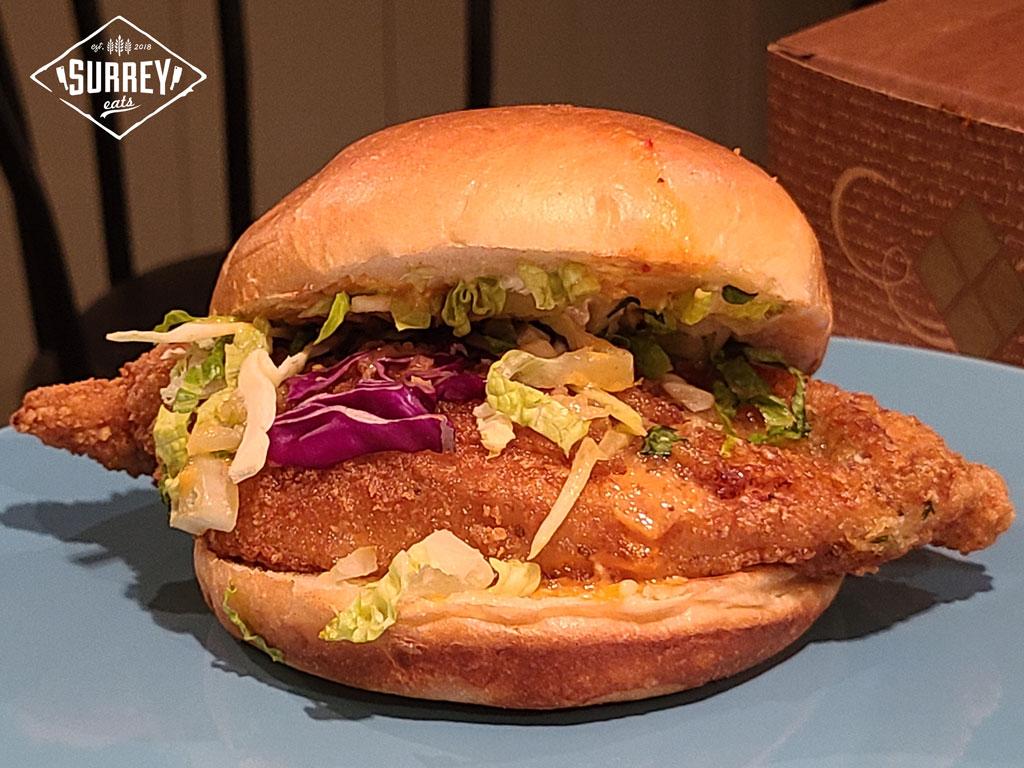 Close-up of a Lemon Pepper Fried Chicken Sandwich from Major Joy
