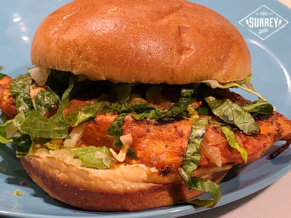 Major Hot Grilled Chicken Sandwich on a blue plate