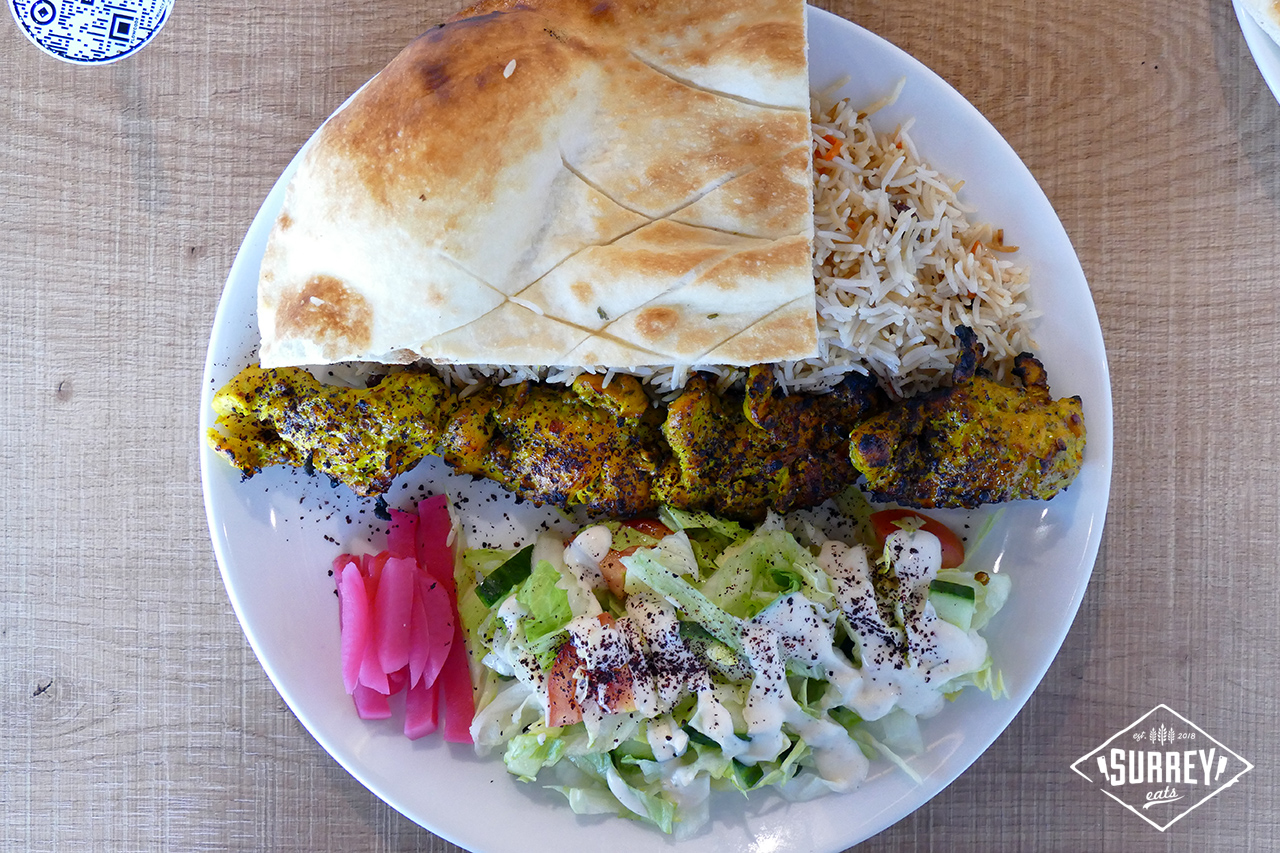 Chicken kabob with rice, salad and Afghan bread