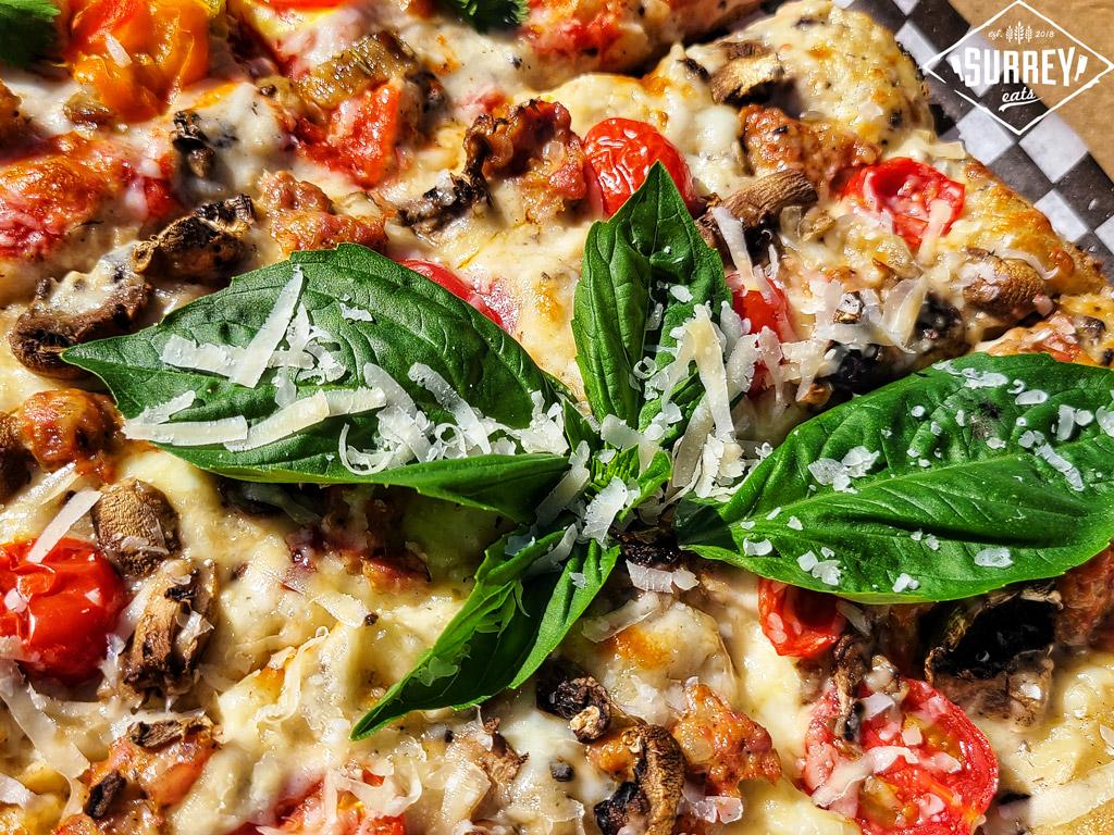 A closeup of the Montanara pizza with fresh basil