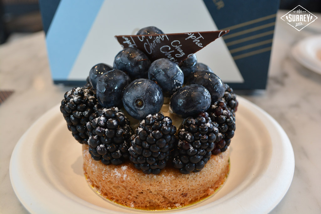 Fresh Fruit Financier with berries and a choclate wedge on top
