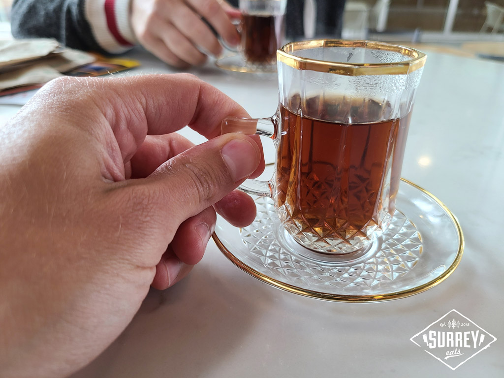 Lebanese tea in tiny glass teacups with saucers