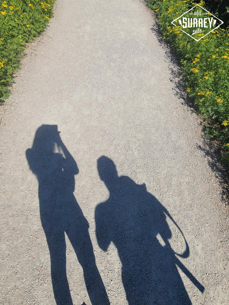The shadows of Matt and Kreezus on a path