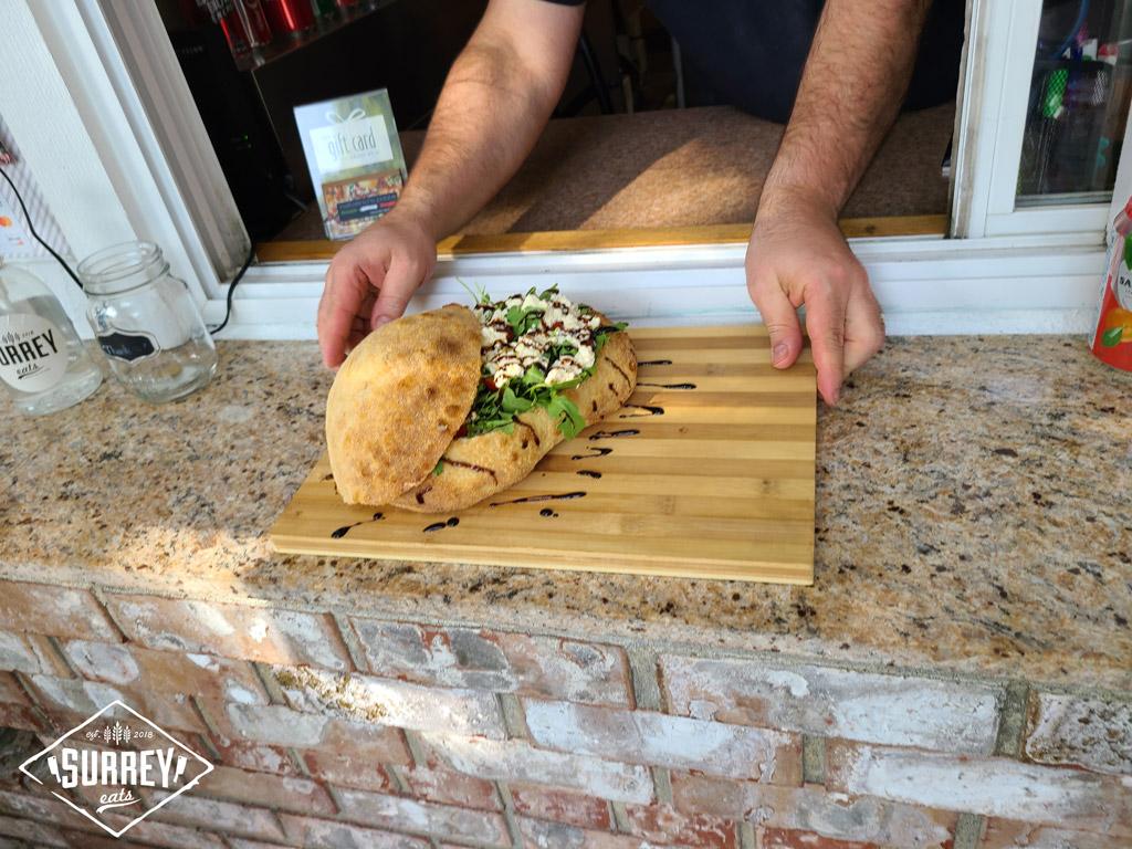Natalino serves a vegan Panzerotti through their take-out window