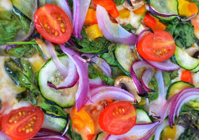 """Close up of """"Explosion of Veggies"""" vegan pizza"""
